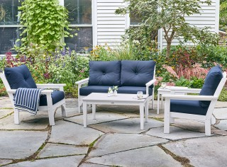 A patio with outdoor furniture.