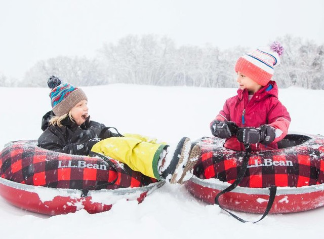 2 happy kids sledding on Sonic Snow Tubes.