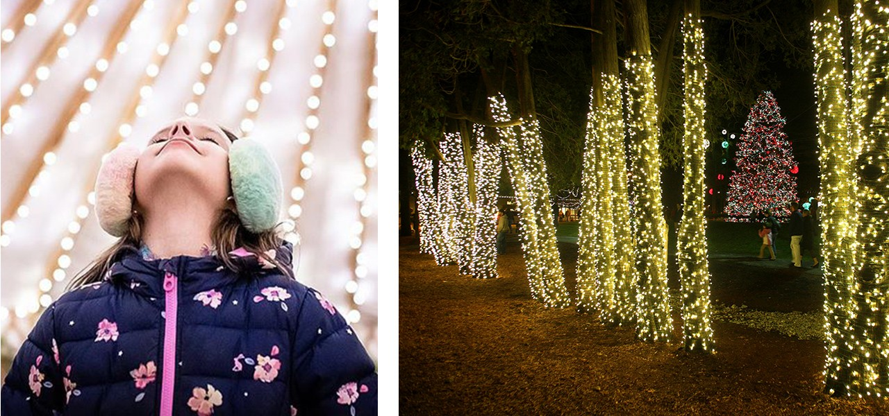 A young girl admiring outdoor holiday lights and an outside winter scene with many lit trees.