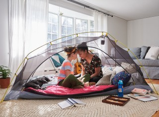 Mother and daughter in a tent in their living room