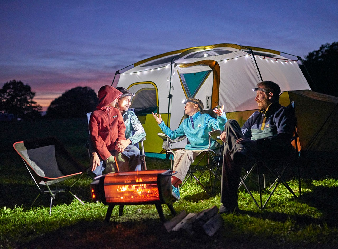 Happy family camping at twilight with L.L.Bean gear