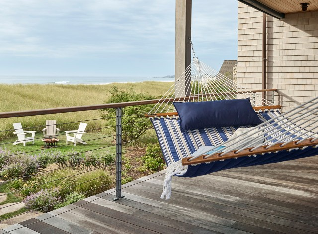 Hammock on porch overlooking beach