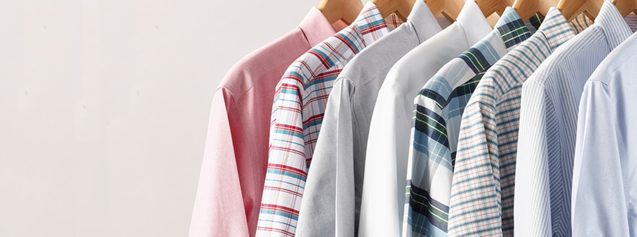 Close-up of 8 Wrinkle Free Oxford Shirts on hangers