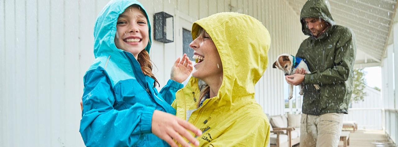 3 people in rainwear.