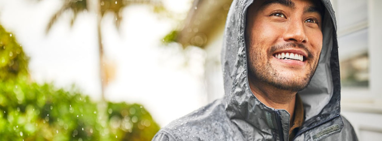 Close up of man in rainwear.