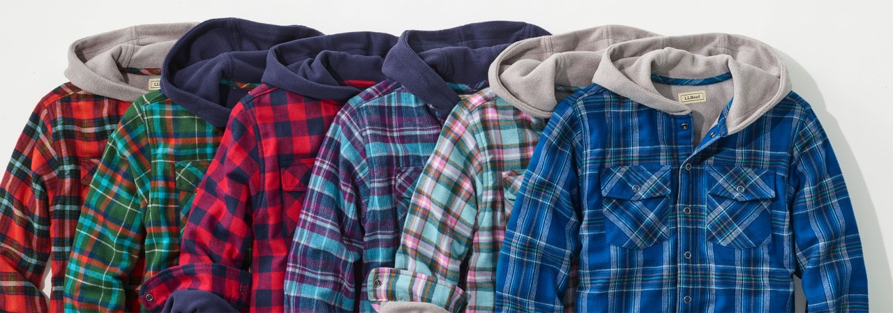 A splay of 6 fleece-lined, hooded flannel shirts for kids.