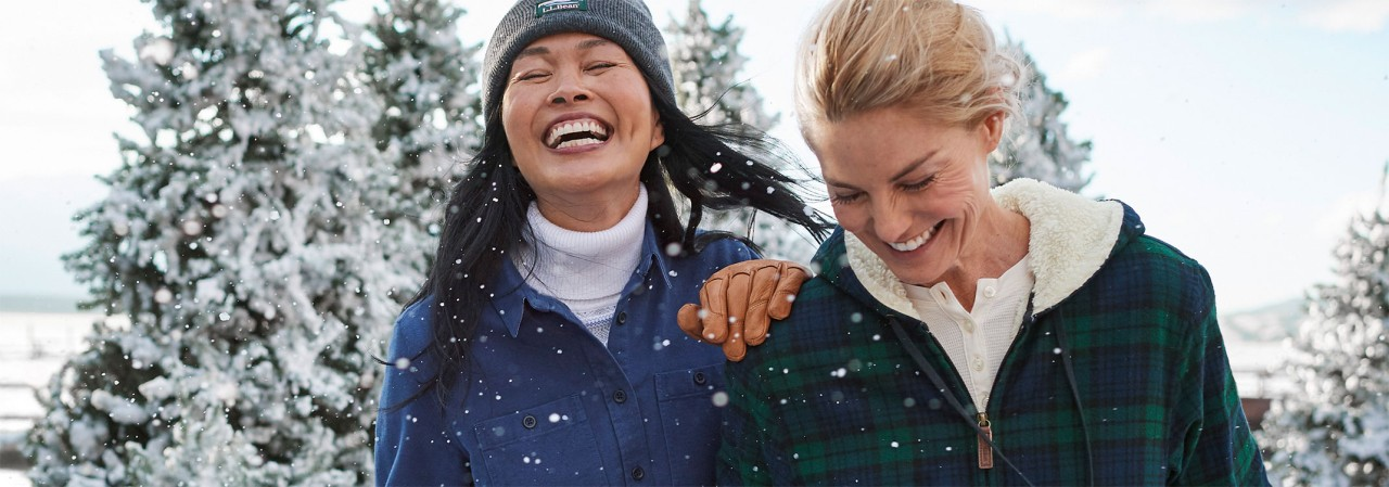 Two women outside in winter wearing flannel shirts.