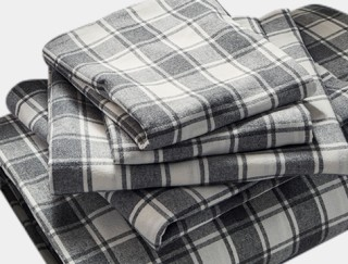 Close-up of folded flannel sheets