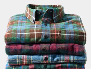 Stack of several flannel shirts