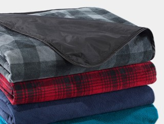 Close-up of stack of outdoor blankets