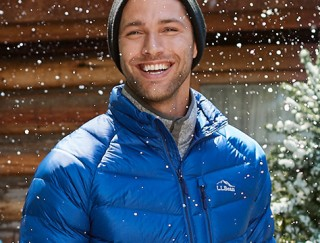 Close-up of smiling man outside in the snow wearing L. L. Bean outerwear.