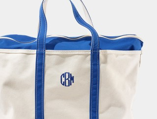 Close-up of monnogrammed tote bag.