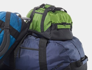 Close-up of 3 adventure duffle bags.