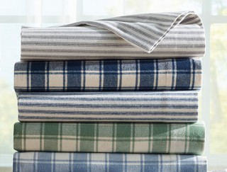 Stack of folded Striped and plaid flannel sheets.