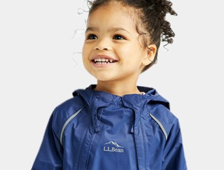 Close-up of smiling toddler wearing an L. L. Bean jacket.