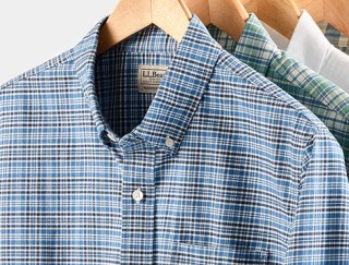 Close-up of three hanging shirts.