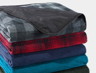 Close-up of stack of outdoor blankets.