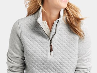 Close-up of woman wearing L.L.Bean pullover.