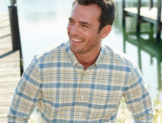 Close-up of smiling man wearing an L.L.Bean plaid shirt.