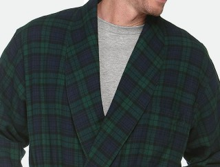 Close-up of man wearing flannel robe.
