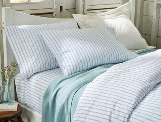 Made bed with striped bedding