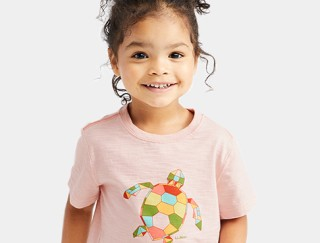 Close-up of smiling toddler wearing an L. L. Bean tee shirt.
