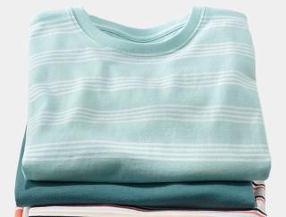 Close up of three hanging of L.L.Bean short sleeve shirts.