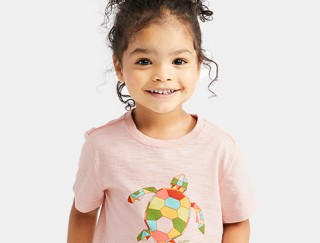 Close-up of toddler wearing L. L. Bean graphic tee.