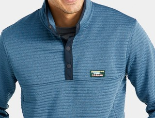Close-up of man wearing L. L. Bean pullover.