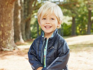 close-up of happy toddler wearing L. L. Bean apparel.