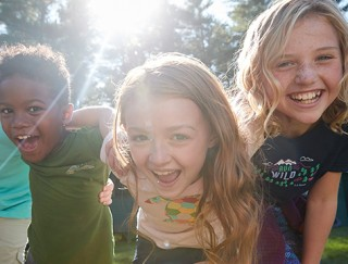 Close-up of 3 laughing kids wearing L. L. Bean kids' apparel.