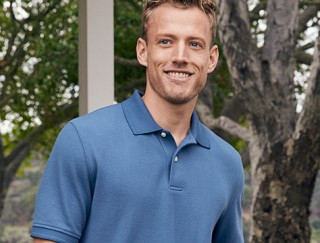 Close-up of man wearing L. L. Bean polo shirt.