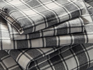 Stack of checked flannel sheets.
