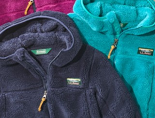 Close-up of 3 kids' fleece hooded jackets.