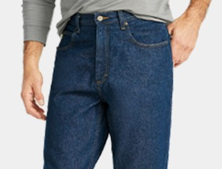 Close-up of man wearing jeans.