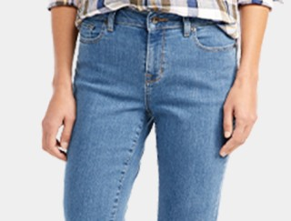 Close-up of woman wearing jeans.