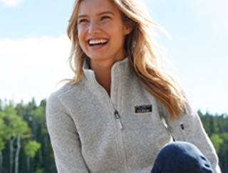 Smiling woman outside in a fleece jacket.