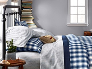 Close-up of bed made up with flannel bedding.