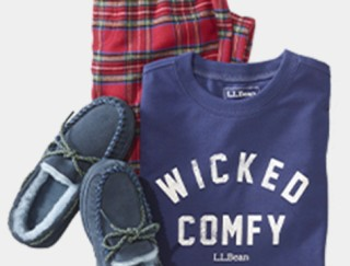 Close-up of kids' sleepwear set - flannel bottoms and long-sleeve knit top, and slippers.