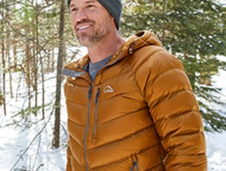 Close-up of man outside in winter wearing down jacket.