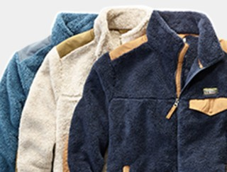 Close-up of 3 men's fleece jackets.