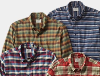 Close-up of 4 flannel shirts.