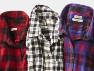 Close-up of 3 flannel shirts.