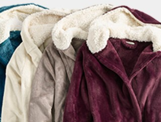 Close-up of 4 women's fleece bathrobes.