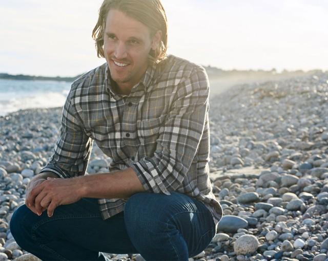 Man on beach wearing jeans