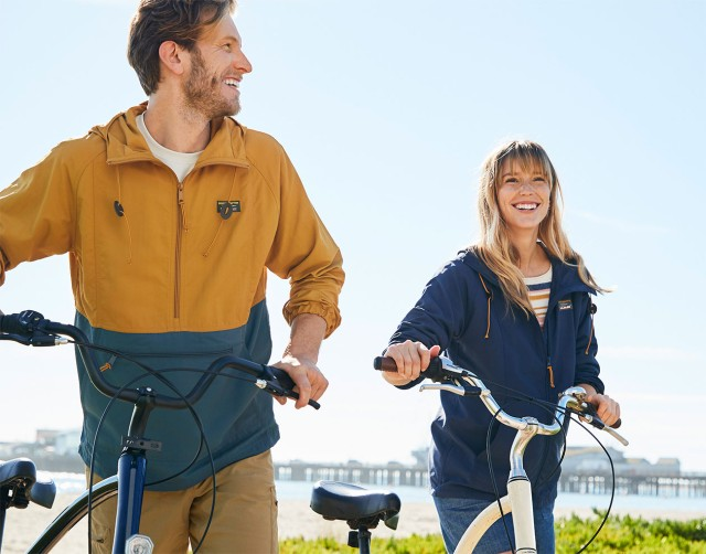 Couple biking on a beach path