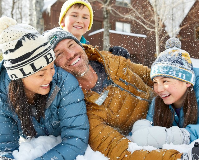 Family playing outside in the snow