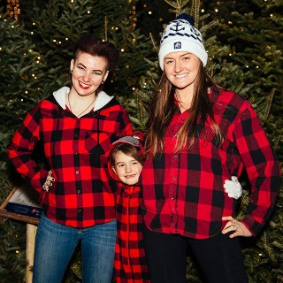 Family all dressed in buffalo plaid flannel.