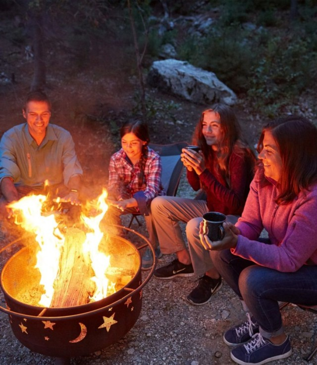 Image of people around a campfire