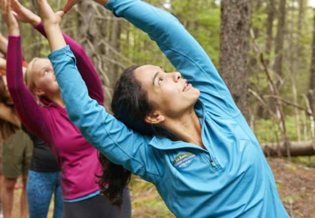 3 women doing socially-distanced yoga outside